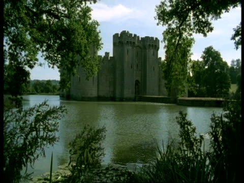 Bodiam Castle, Sussex - overhanging foreground trees, river Rother in foreground