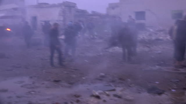 bodies being removed from rubble in idlib after a syrian government forces air strike - air raid stock videos & royalty-free footage