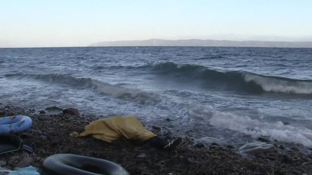 bodies found on a beach on the greek island of lesbos were believed to be migrants from recent shipwrecks of boats trying to cross the aegean sea... - refugee stock videos & royalty-free footage