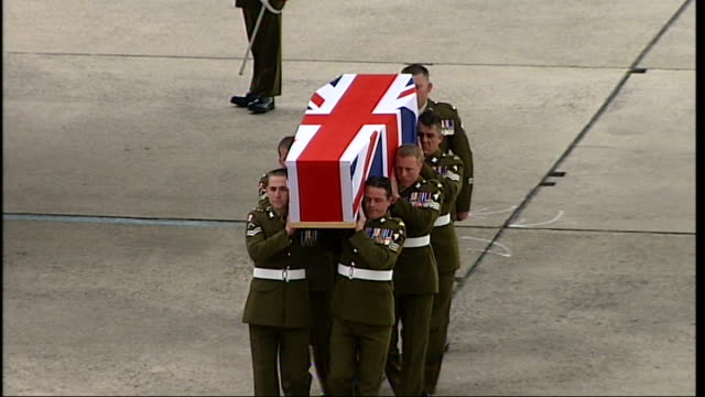 bodies of three british soldiers repatriated more of soldiers carrying coffin along to hearse - hearse stock videos & royalty-free footage
