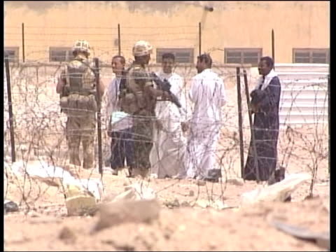 bodies of two british soliders found itn iraq al zubayr area where shallow graves of british soldiers staff sergeant simon cullingworth and sapper... - army helmet stock videos & royalty-free footage