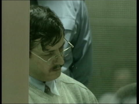 bodies of two missing girls discovered in liege lib marc dutroux in dock behind bullet proof glass - ベルギー点の映像素材/bロール