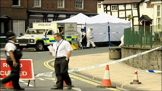 bodies of two women found in suspected massage parlour in shrewsbury; england: shropshire: shrewsbury: ext police van and tent in cordoned-off area... - roswell stock videos & royalty-free footage