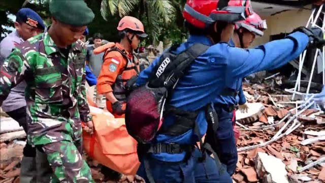 body bags are hauled away from buildings flattened by indonesia's volcano triggered tsunami as the death toll climbed to 373 and search teams pushed... - indonesia stock videos & royalty-free footage