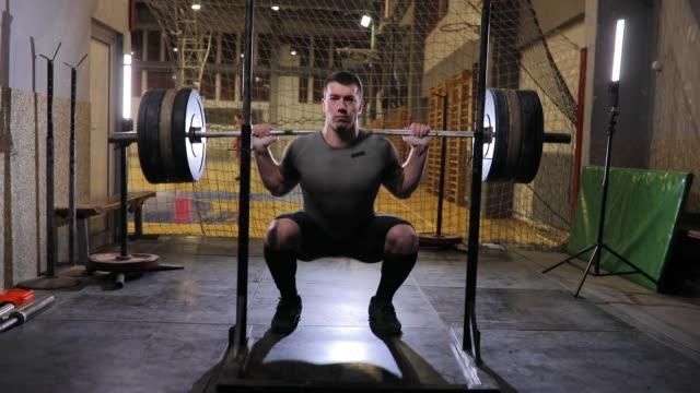 Body builder exercising alone