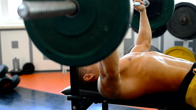 body builder lifting weights on bench press - pectoral muscle stock videos and b-roll footage