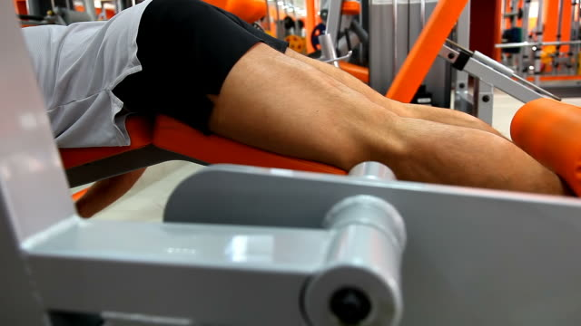 body builder - prone leg curl - exercise machine stock videos & royalty-free footage
