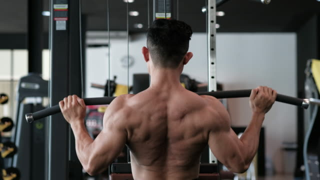 body builder with lat pulldown - lateral pull down weights stock videos & royalty-free footage