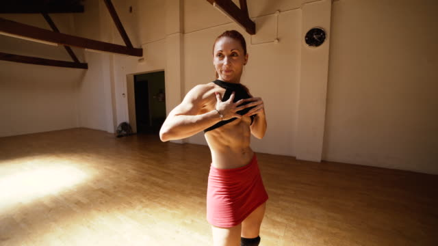 body builder woman in a gym dance floor - washboard stock videos and b-roll footage