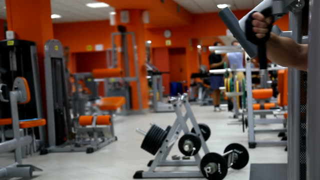 Body builders in fitness club. Background