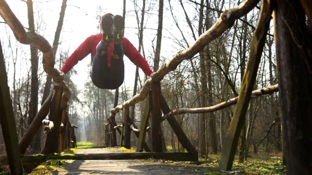 hd dolly: body building exercises on a footbridge - pull ups stock videos & royalty-free footage