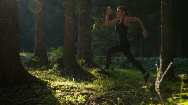 body conscious woman on a morning jog - cross country running stock videos and b-roll footage