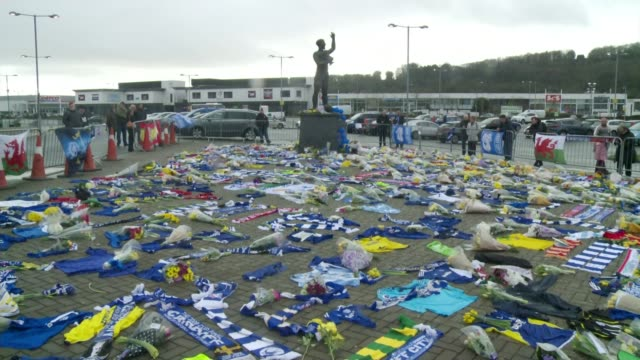 Body found in wreckage of Emiliano Sala's plane in English Channel Cardiff Cardiff City Stadium EXT Floral tributes tshirts and scarves left outside...