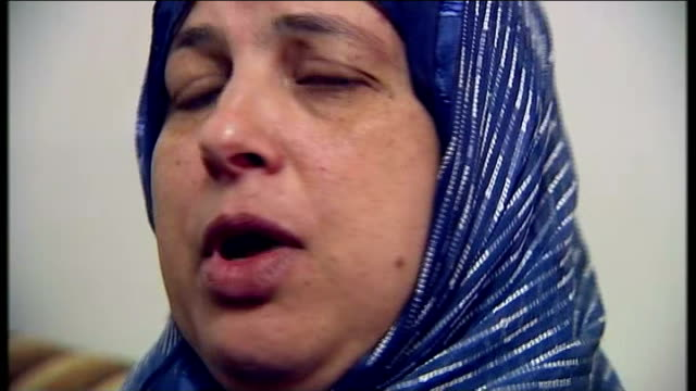 body of abducted palestinian teenager discovered int relatives of mohamed abu khadeir sat in family home suha abu khadeir surrounded by press... - security screen stock videos & royalty-free footage
