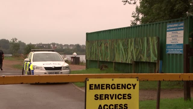 police at scene england kent maidstone ext 'leybourne lakes' welcome sign / police along / police car / general views of lake - triathlete stock videos and b-roll footage