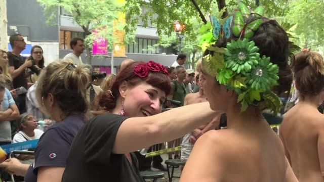 stockvideo's en b-roll-footage met body painting day was held in new york on saturday with enthusiasts many of them naked gathering to have designs painted on themselves to celebrate... - naturist