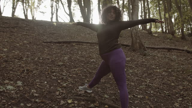 body positive black female stretching exercising outdoors in forest, plus size obese overweight black woman sports training - hourglass stock videos & royalty-free footage