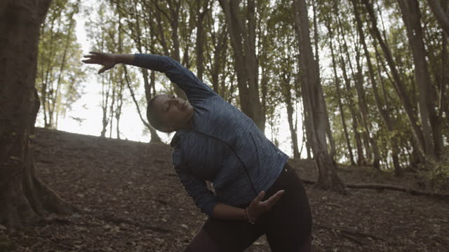 body positive black female yoga exercise outdoors, plus size obese overweight black woman meditating in forest - overweight yoga stock videos & royalty-free footage