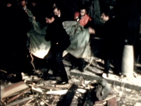 body removed from wreckage of public house following bomb attack 21 november 1974 - birmingham england stock videos & royalty-free footage