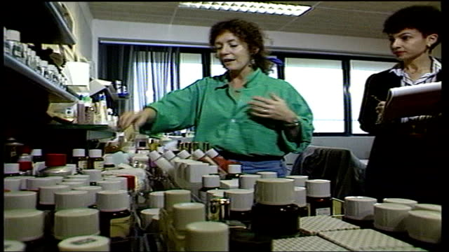 body shop founder anita roddick has hepatitis c tx anita roddick looking at products in bottles next woman holding a clipboard dissolve to - founder stock videos and b-roll footage