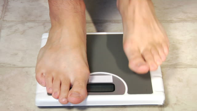 body weight scale - comparison stock videos and b-roll footage