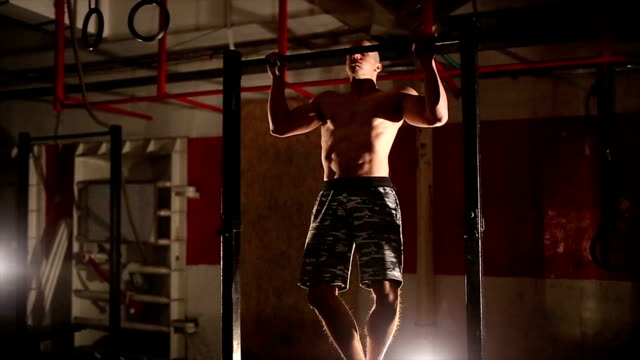 bodybuilder doing pull ups best back exercises - chin ups stock videos and b-roll footage