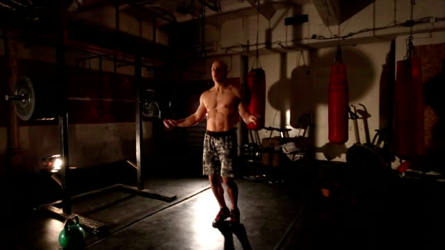 Bodybuilder exercising with a rope