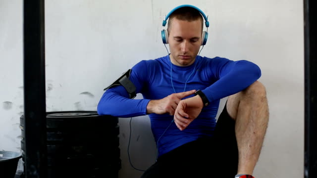 bodybuilder in the gym using smart watch - bracelet stock videos and b-roll footage