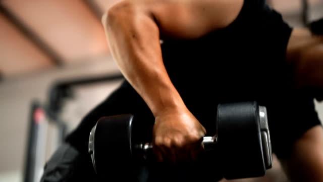 SLO MO - Bodybuilder Lifting Dumbbell