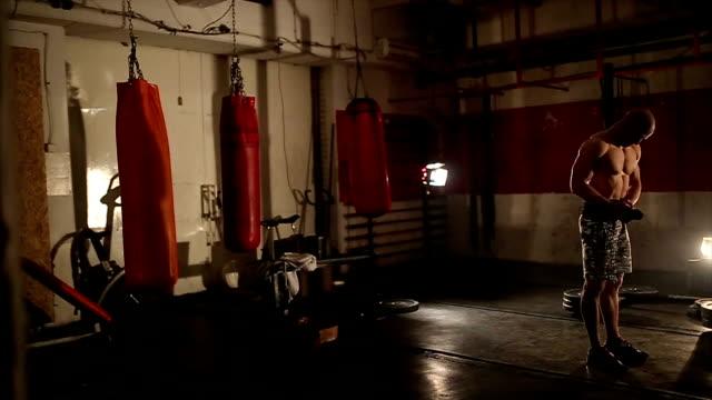 Bodybuilder preparing for weightlifting