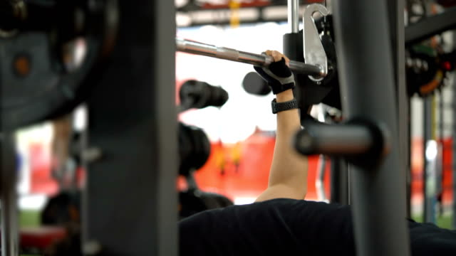 Bodybuilder Training with Barbell on Bench Press