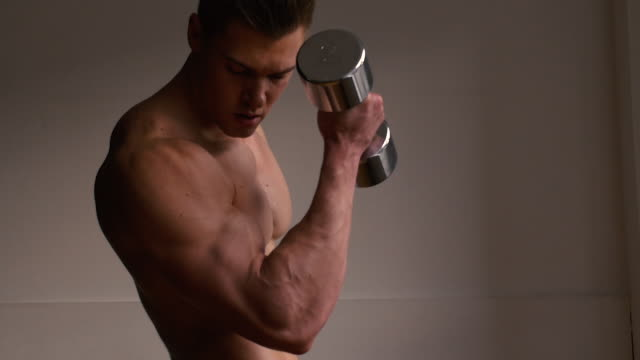 bodybuilder using free weights - bicep stock videos and b-roll footage