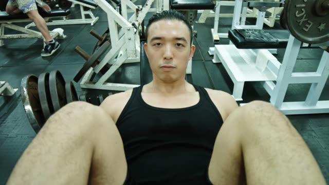 bodybuilder using leg press machine - leg press stock videos & royalty-free footage