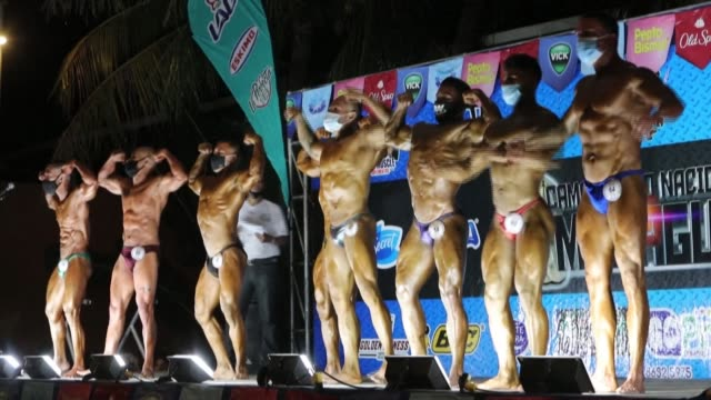 bodybuilders, wearing face masks, take part in the national bodybuilding championship in managua amid the new coronavirus pandemic - managua stock videos & royalty-free footage