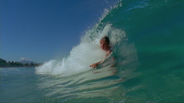 SLO MO, MS, CU, Bodysurfer on ocean wave, Oahu's North Shore, Hawaii, USA