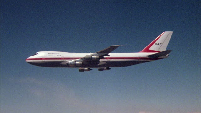 A Boeing 747 flies through the sky.