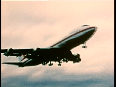 boeing 747 jet airliner takes off from a runway and flies above the clouds. - 1970 stock videos & royalty-free footage
