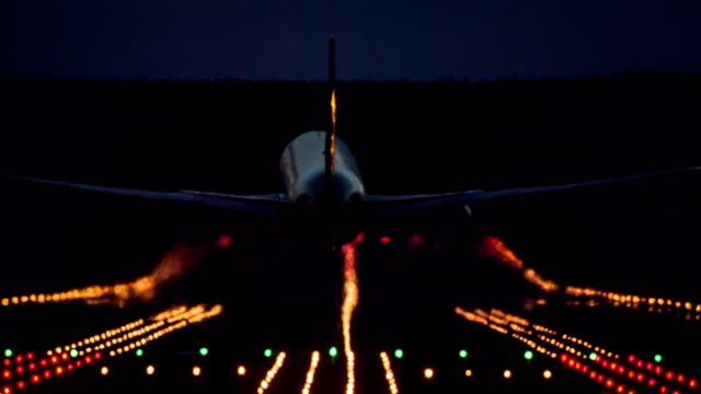 boeing 767 landing at night. - airport runway stock videos & royalty-free footage