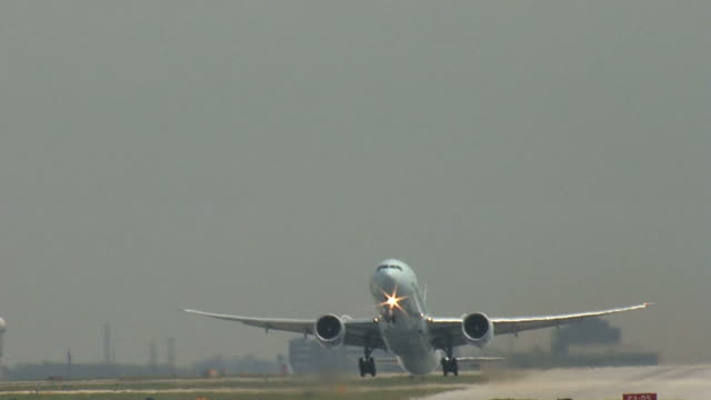 boeing 777 airplane takeoff straight on - taking off stock videos and b-roll footage