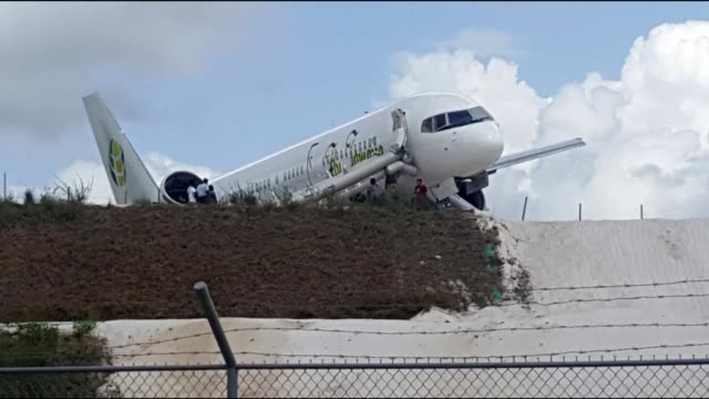 boeing airliner carrying 82 canadians is seen after it crash lands in guyana's capital georgetown skidding to a halt just before a steep drop - guyana stock videos & royalty-free footage