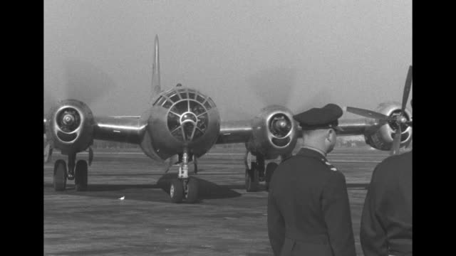 Boeing B29 Superfortress flown by Col Clarence Irvine and crew landing / plane taxis and stops in front of General Henry Arnold Chief of Army Air...