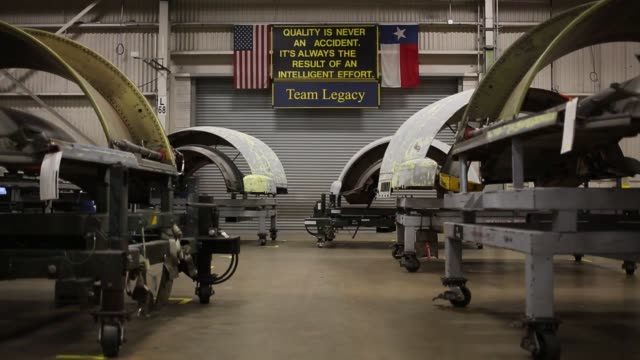 boeing c17 globemaster iii airplanes sit parked inside a hangar at the boeing company's global services and support san antonio facility in san... - ボーイング点の映像素材/bロール