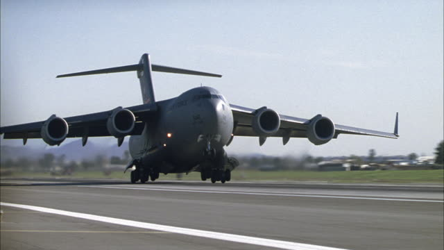 a boeing c-17 globemaster iii military transport plane takes off after a brief landing. - boeing stock videos & royalty-free footage