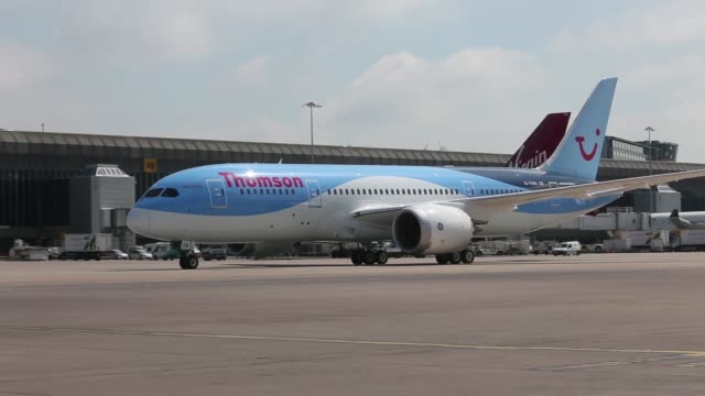 a boeing co 787 dreamliner aircraft operated by tui travel plc's thomson airways taxis on the runway after landing at manchester airport in... - boeing 787 stock videos and b-roll footage