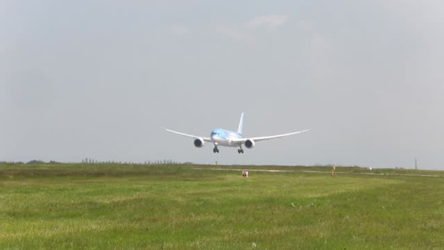 a boeing co 7878 dreamliner aircraft operated by thomson airways comes into land on runway at manchester airport in manchester thomson airways take... - boeing 787 stock videos and b-roll footage