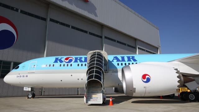 a boeing co 7879 dreamliner passenger aircraft operated by korean air lines co stands on the tarmac during a media preview at incheon international... - tail wing stock videos and b-roll footage