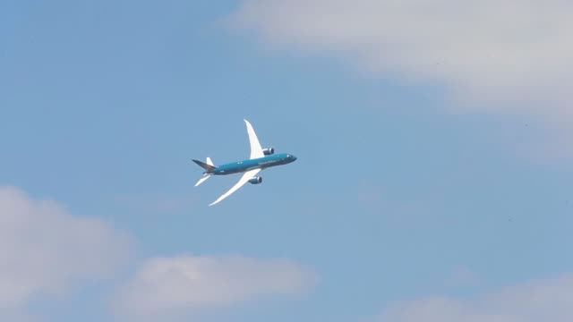 a boeing co b7879 dreamliner operated by vietnam airlines corp performs a flying display on the opening day of the 51st international paris air show... - boeing 787 stock videos and b-roll footage