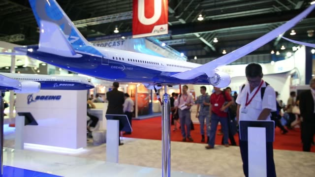 boeing co signage at the company's booth at the singapore airshow held at the changi exhibition centre in singapore on thursday feb 13 various shots... - boeing 787 stock videos and b-roll footage