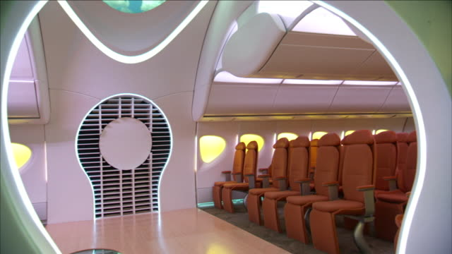 a boeing concept jet features plush, aerodynamic seating in the passenger cabins. - boeing stock videos & royalty-free footage