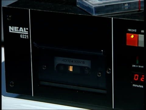 cassette tape turning in recorder in interrogation room cs ditto - interrogation stock videos & royalty-free footage